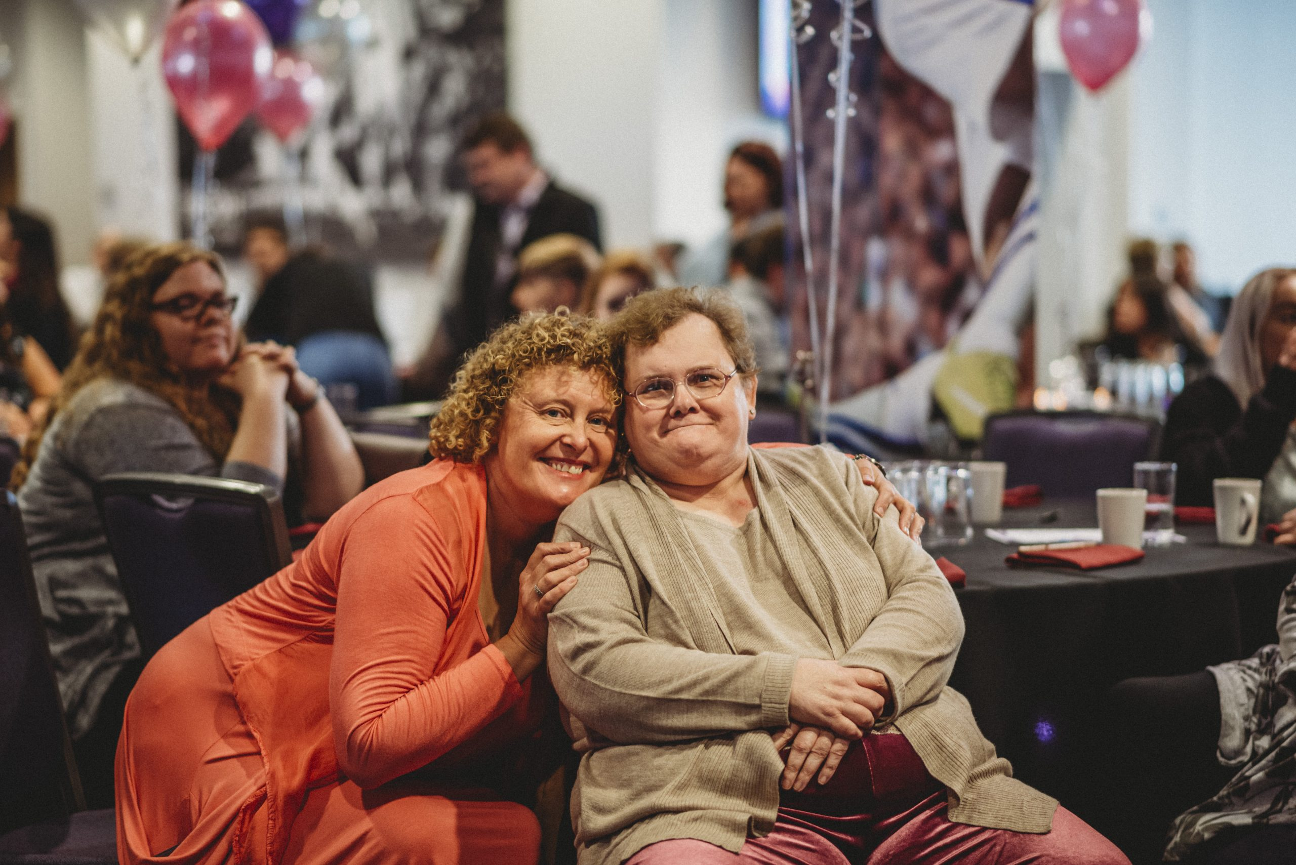 Staff member and person supported smile at the camera at our mirus stars event