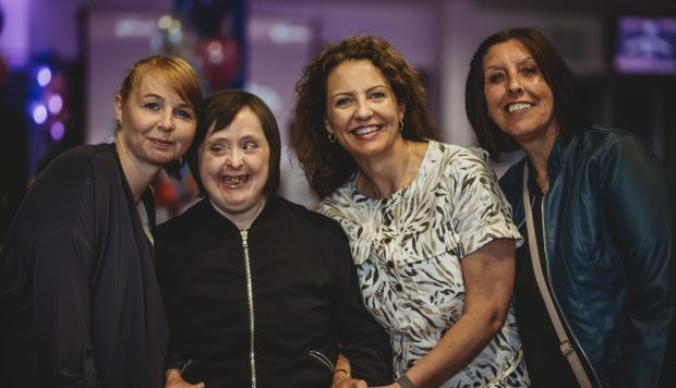 Four females grouped together smiling at the camera at our mirus stars event