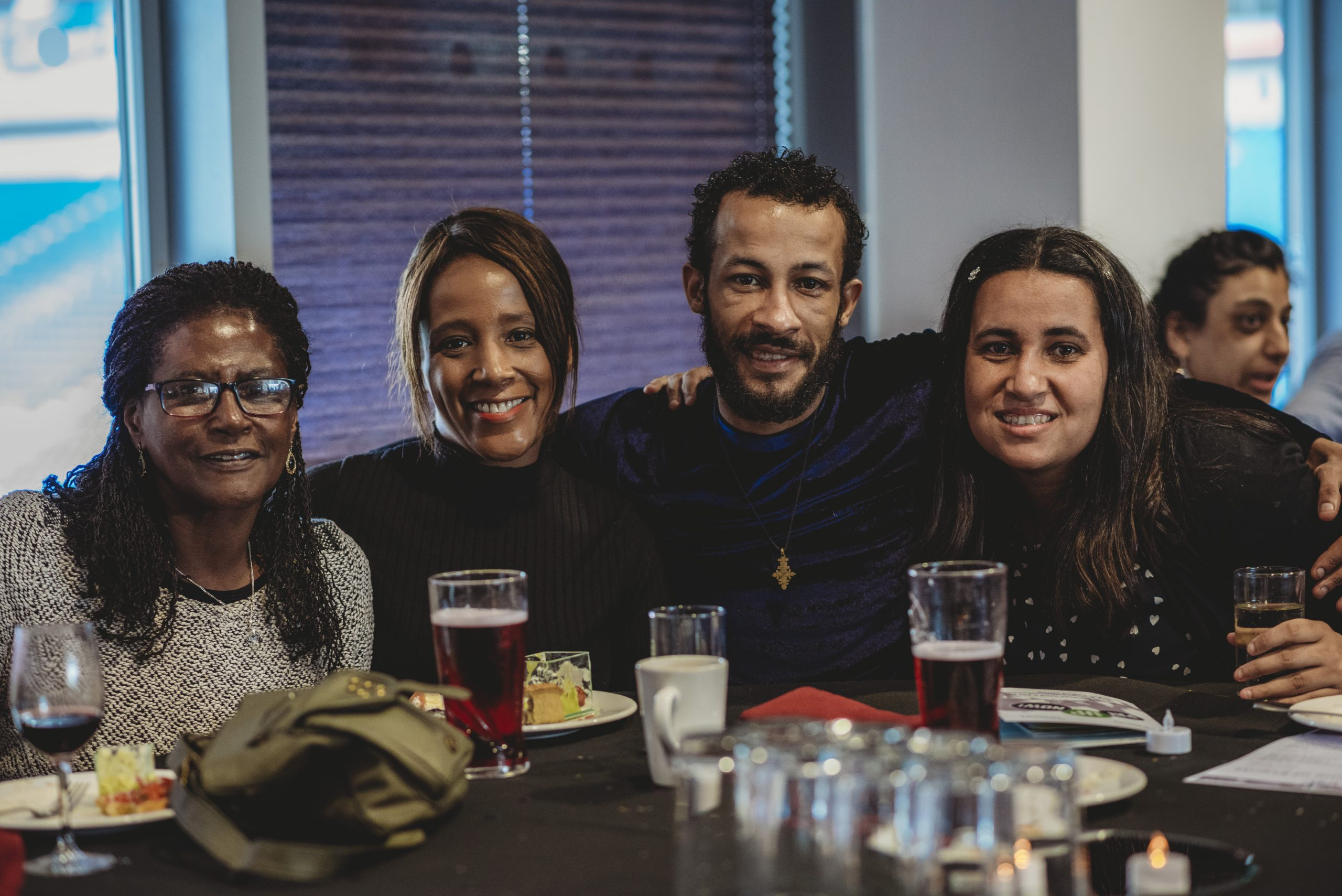 Four people sat at a table smiling at the camera at our mirus stars event